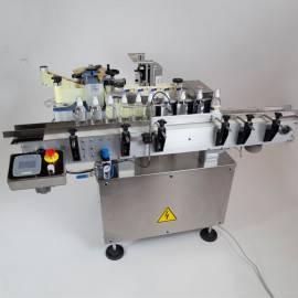Sistema 1 Etichettatrice per flaconi cilindrici